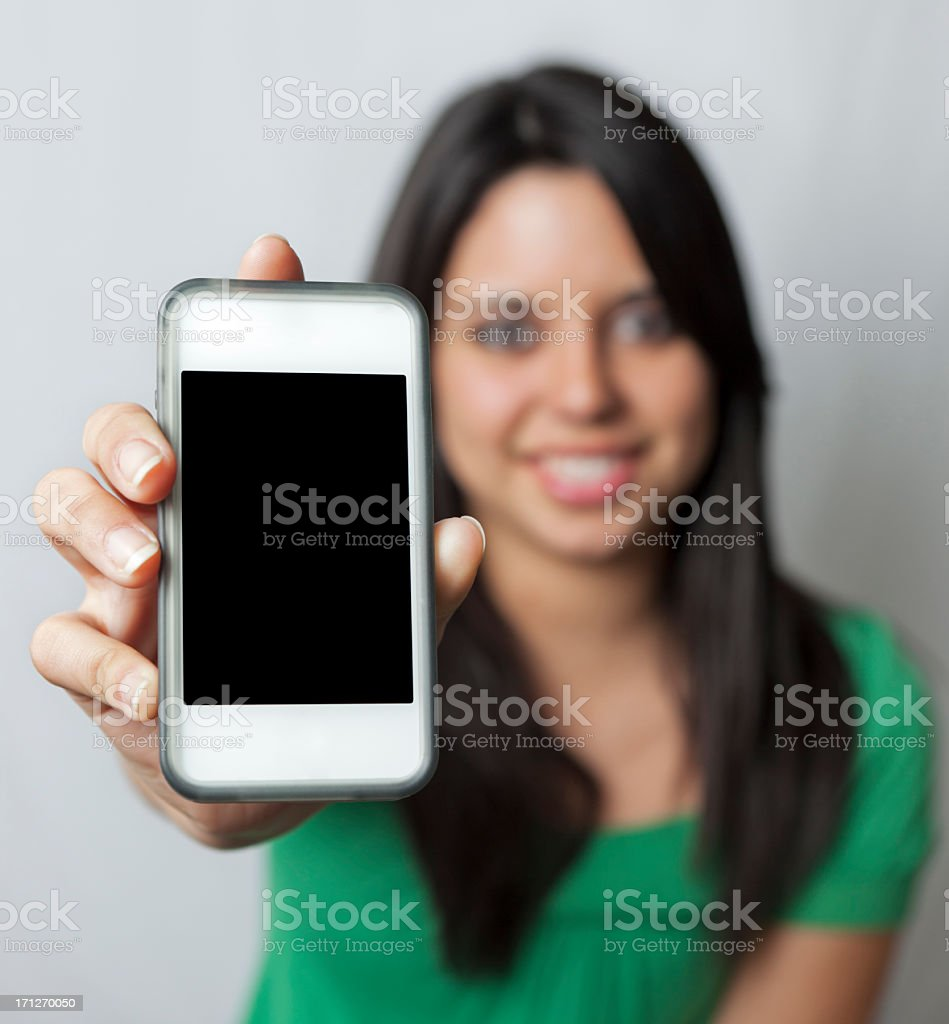 Teen holding cell phone royalty-free stock photo