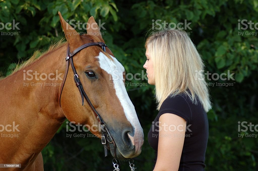 Teen Identifying her Horse's Body Language stock photo