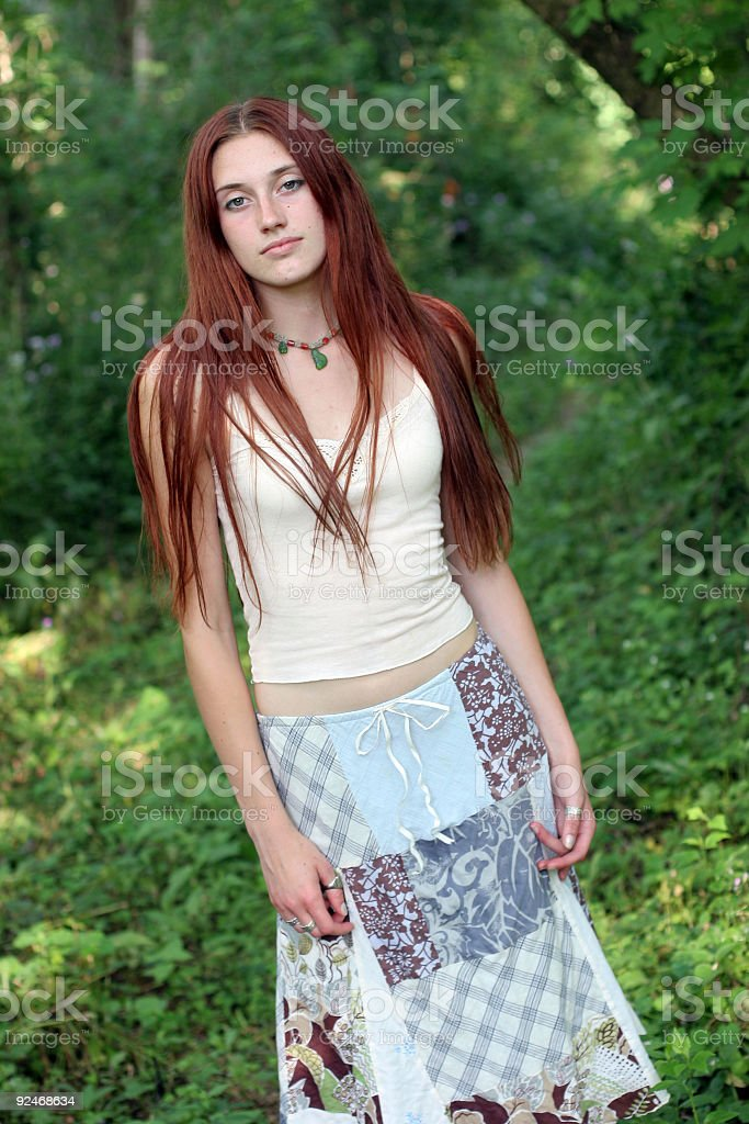 Teen in forest stock photo