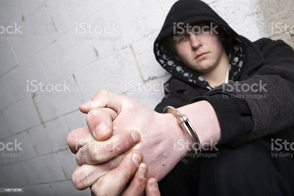 teen in handcuffs stock photo