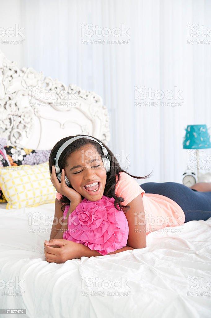 Teen listening to music stock photo