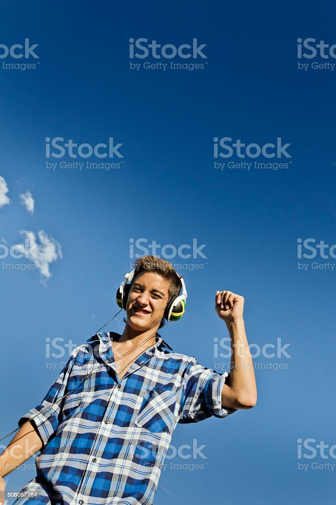 Teen listening to music stock photo