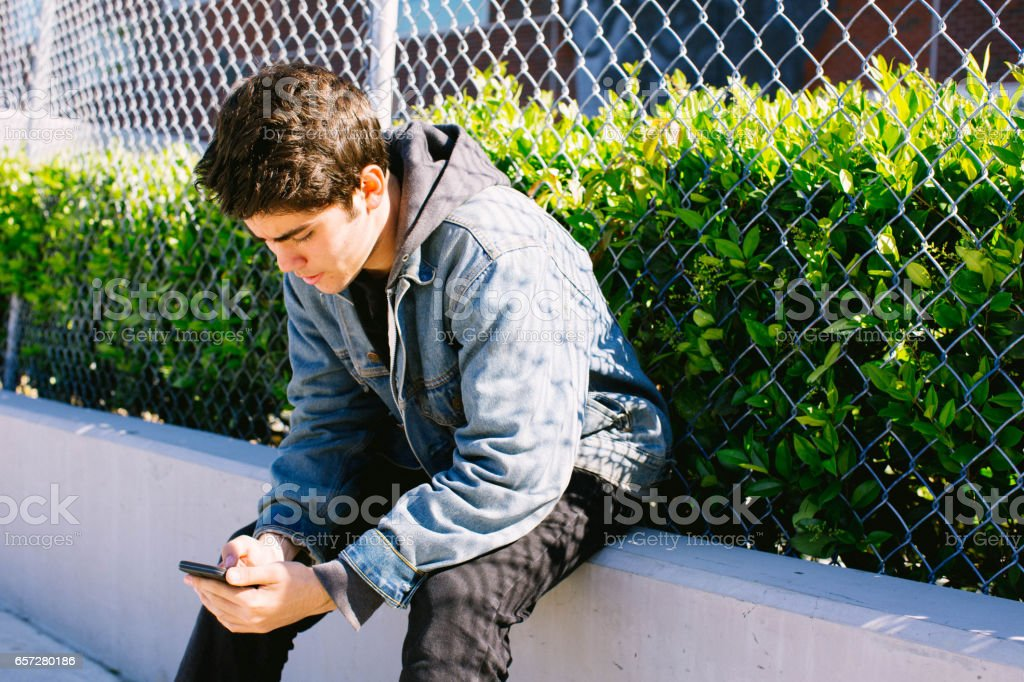 Teen On Cell Phone stock photo
