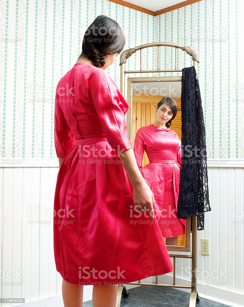 Teen or Young Woman Peeks Into a Mirrow royalty-free stock photo
