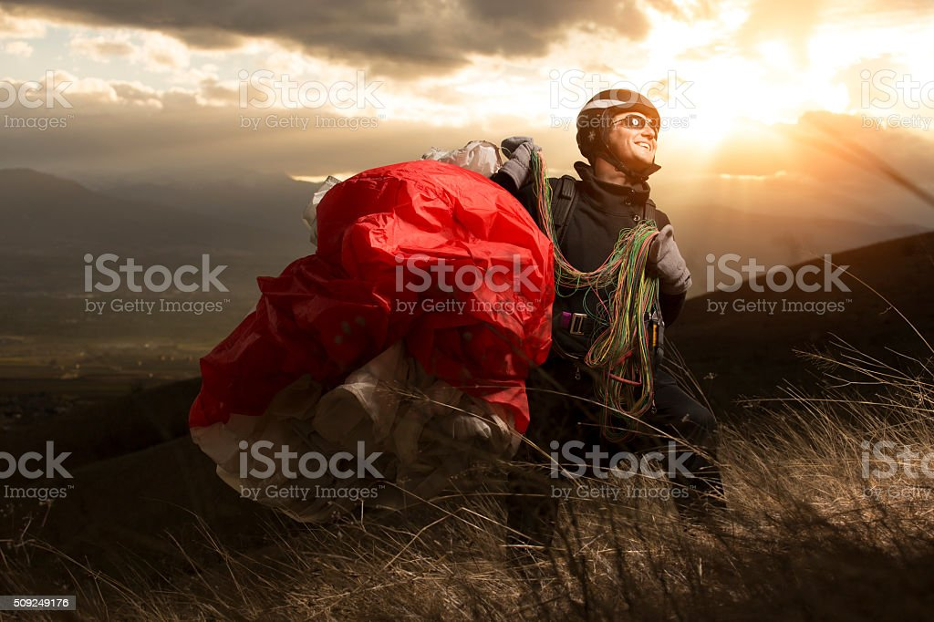 Teen paragliding stock photo