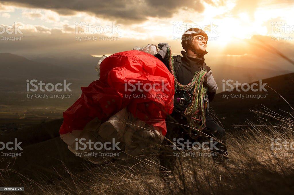 Teen paragliding stock photo