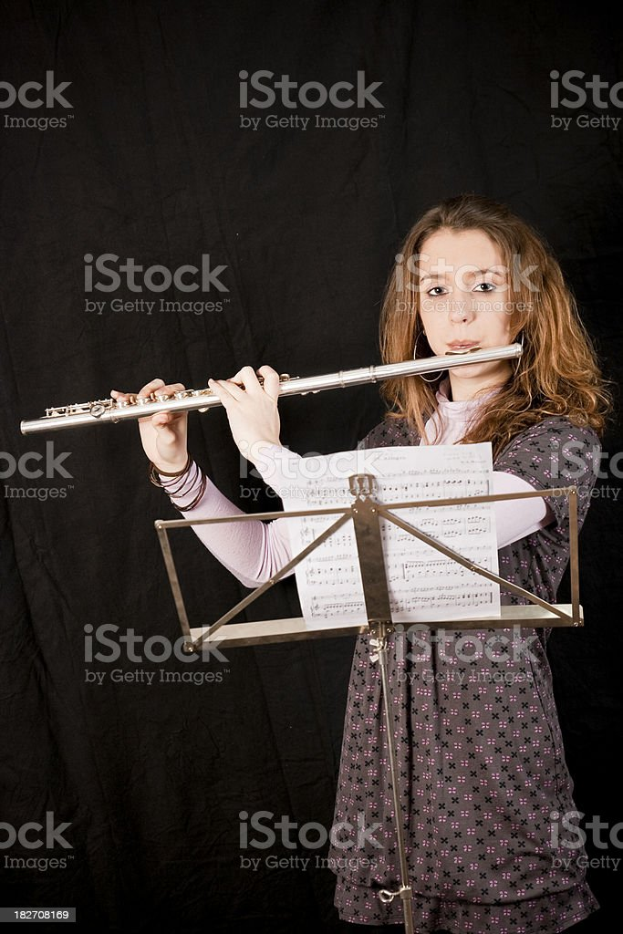 Teen playing the flute stock photo