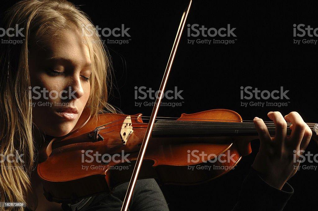 Teen playing violin royalty-free stock photo