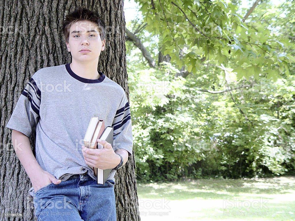 teen portaits - boy against tree royalty-free stock photo