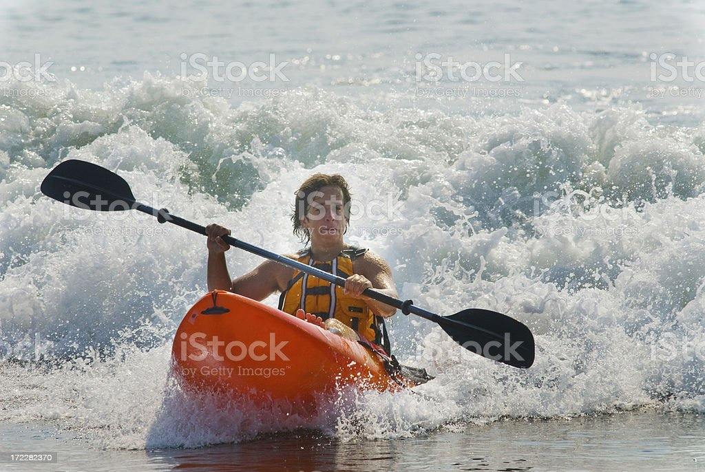 Teen Riding Wave in Ocean Kayak royalty-free stock photo