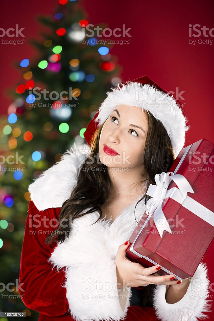 Teen Santa Claus wondering what she got as a gift royalty-free stock photo