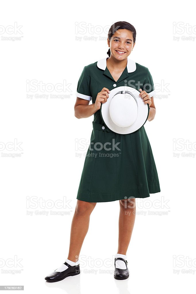 teen school girl holding a hat royalty-free stock photo