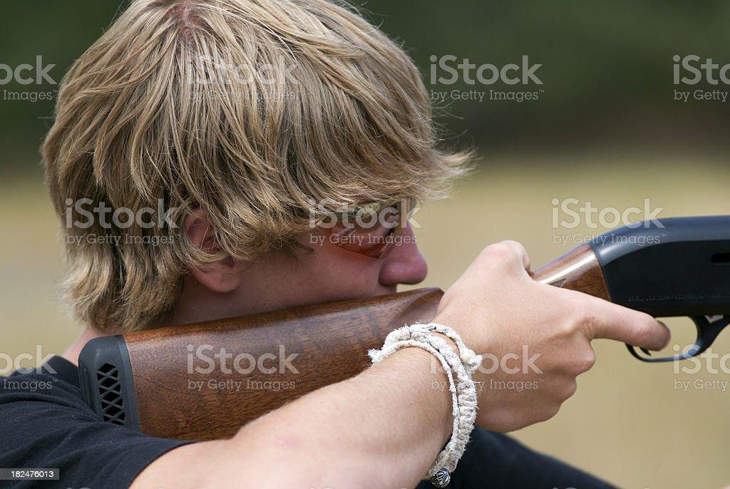 Teen shooting a gun royalty-free stock photo