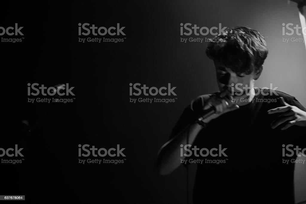 B&W teen singer stock photo