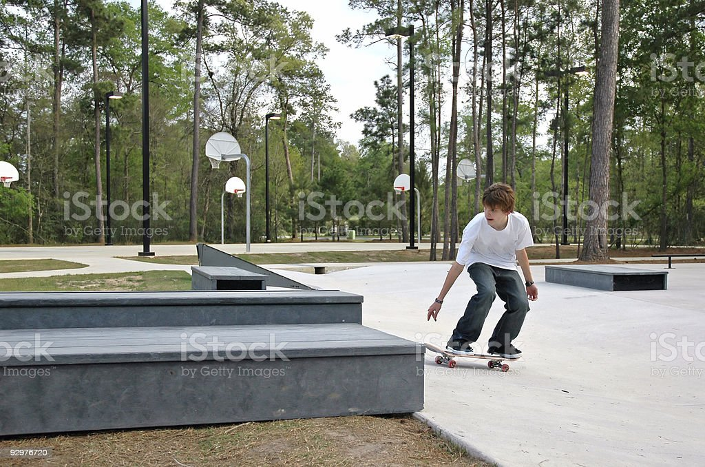 Teen Skater at the Park stock photo
