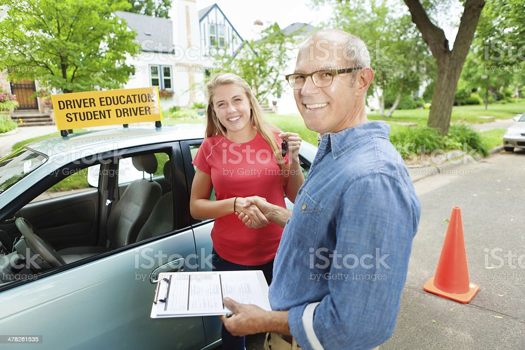 Teen Student Driver Shaking hand with Driver Examination Personel Vertical stock photo