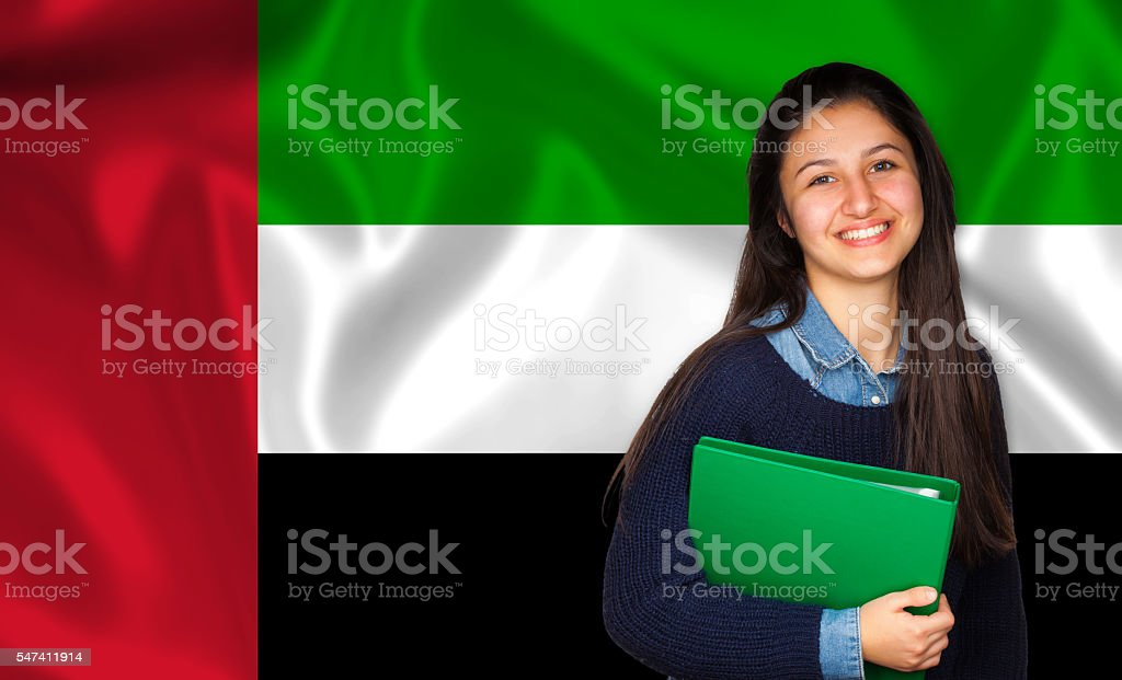 Teen student smiling over United Arab Emirate flag stock photo