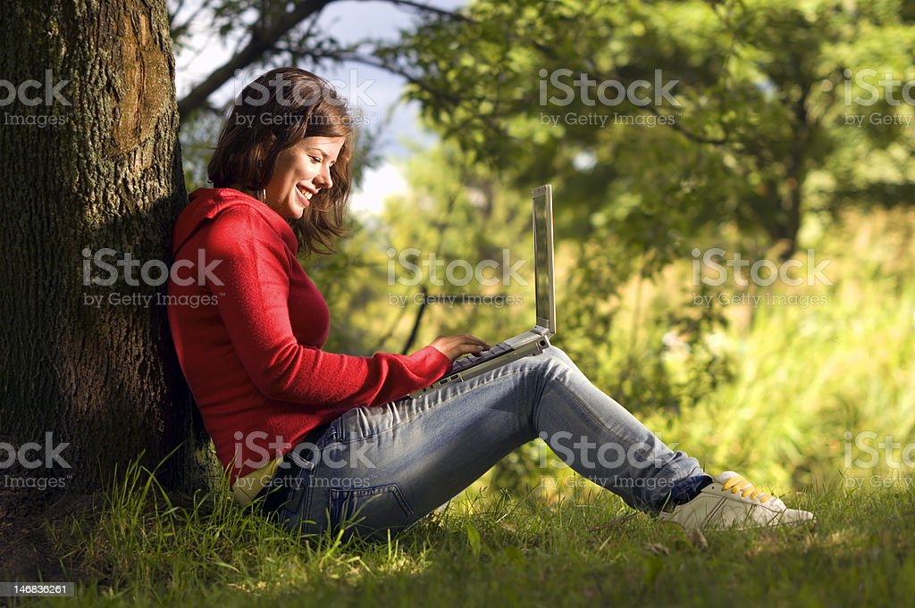Teen student working outdoor royalty-free stock photo