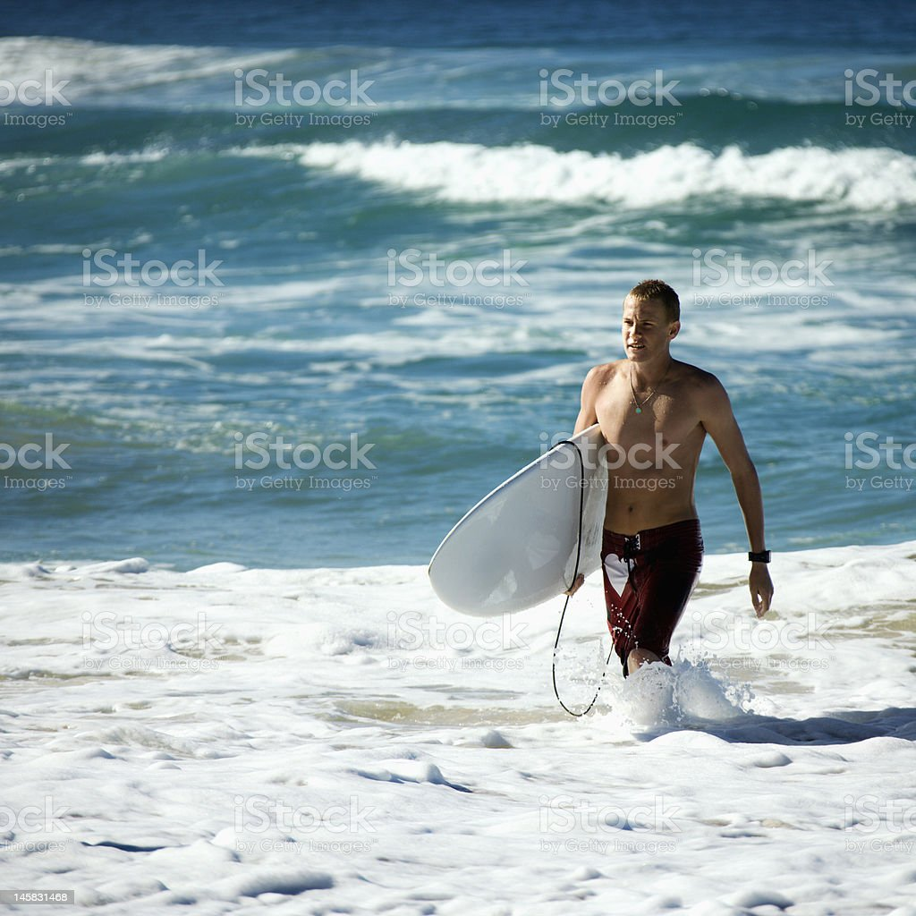 Teen surfer in water. royalty-free stock photo