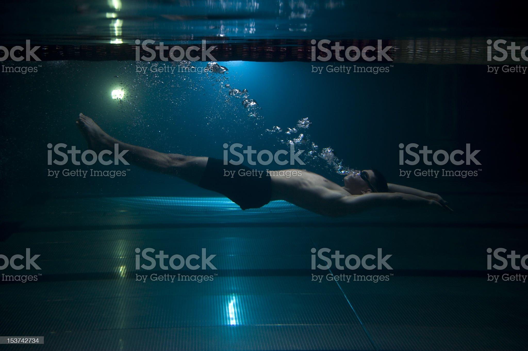 Teen swimming underwater upsidedown delphin royalty-free stock photo