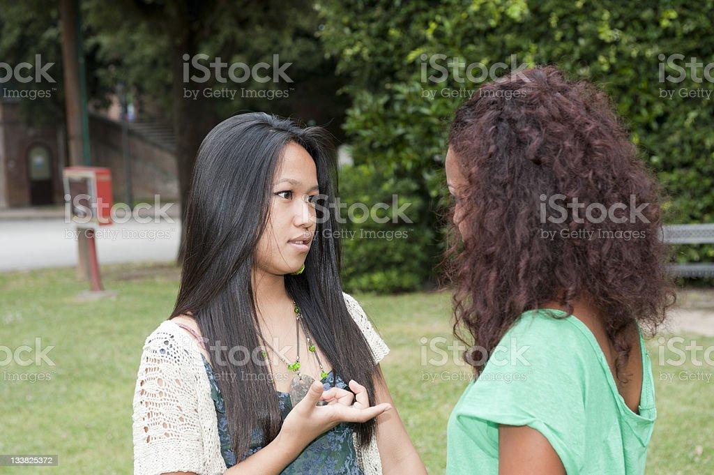 Teen talking at park stock photo
