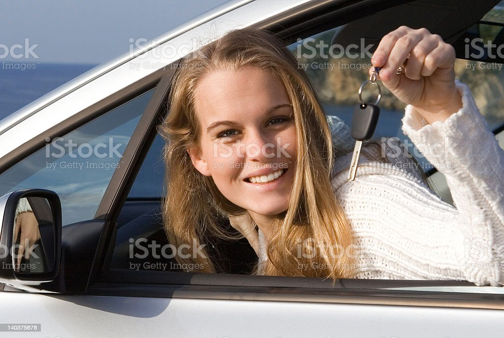 teen teenager or youth  holding keys to new car stock photo