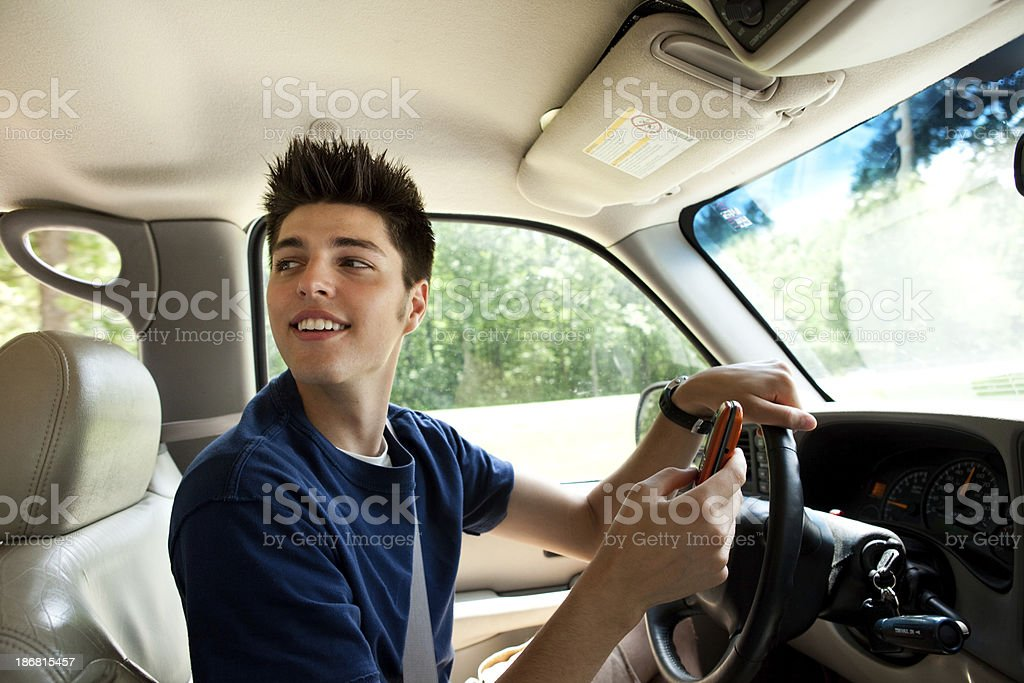 Teen texting while driving stock photo