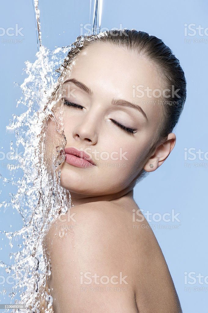 Teen under splash of water stock photo