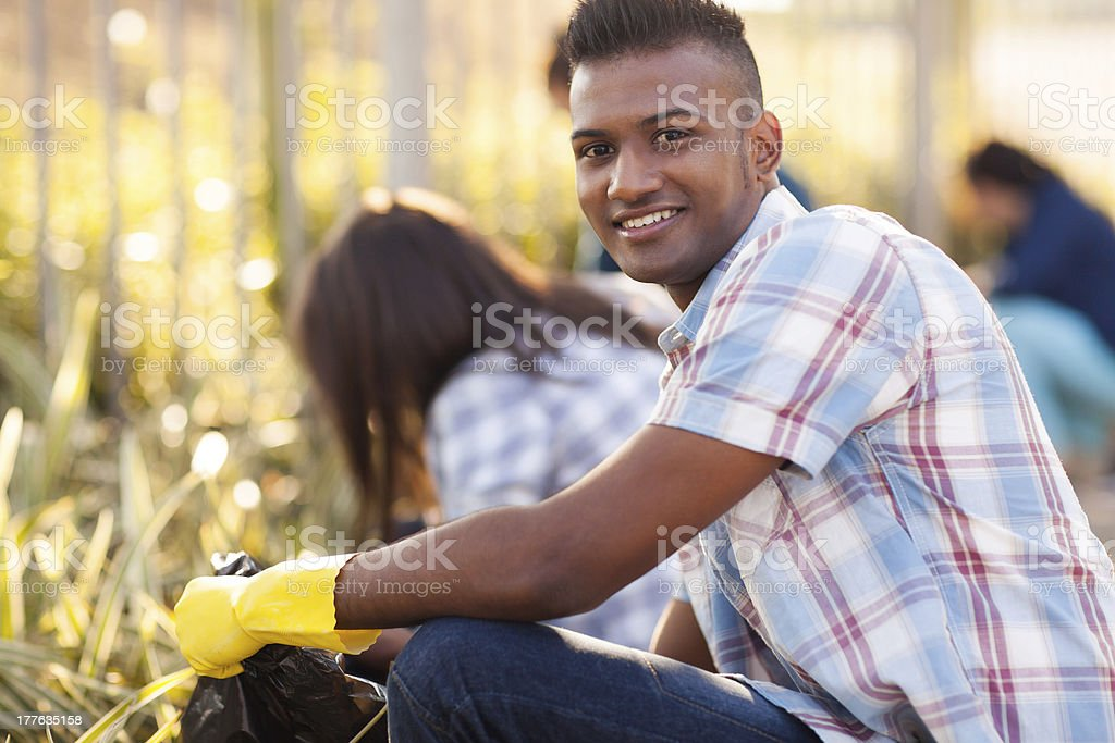 teen volunteers cleaning streets stock photo