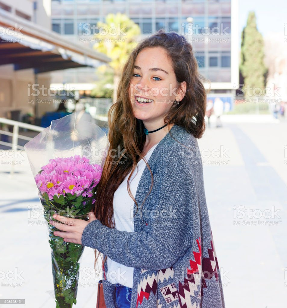 Teen with bouquet of flowers stock photo