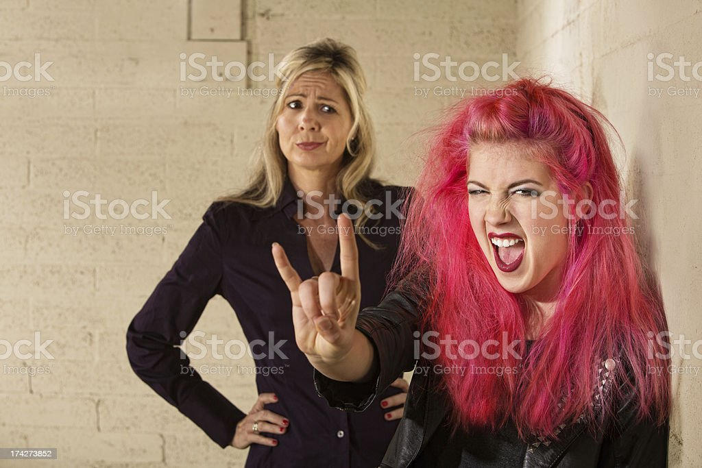 Teen with Doubting Adult stock photo