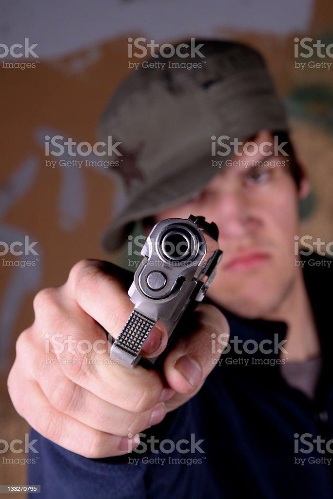Teen with gun stock photo