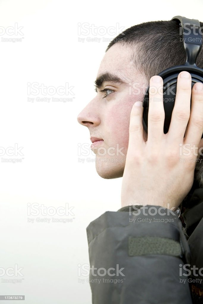 Teen with headphones side looking royalty-free stock photo