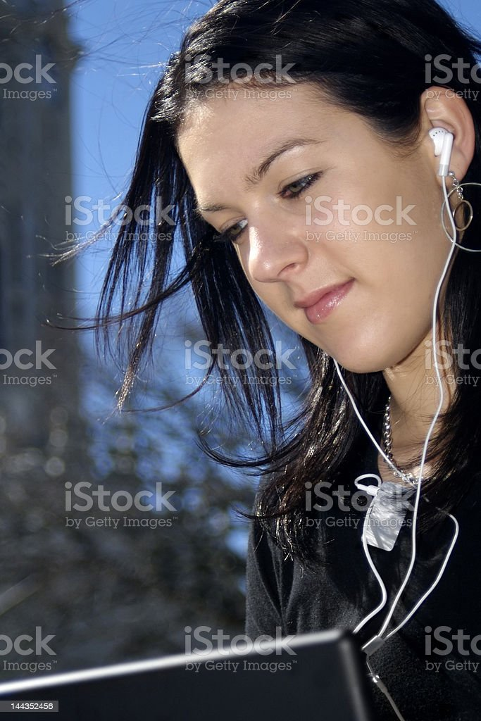 Teen with Laptop/ MP3 royalty-free stock photo