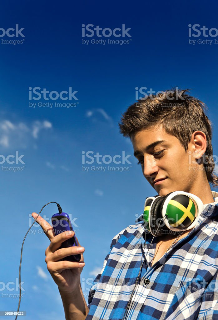 Teen with smartphone stock photo