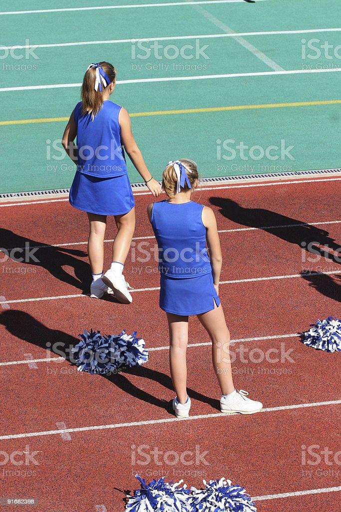 Teen Youth Cheerleaders on Sidelines stock photo