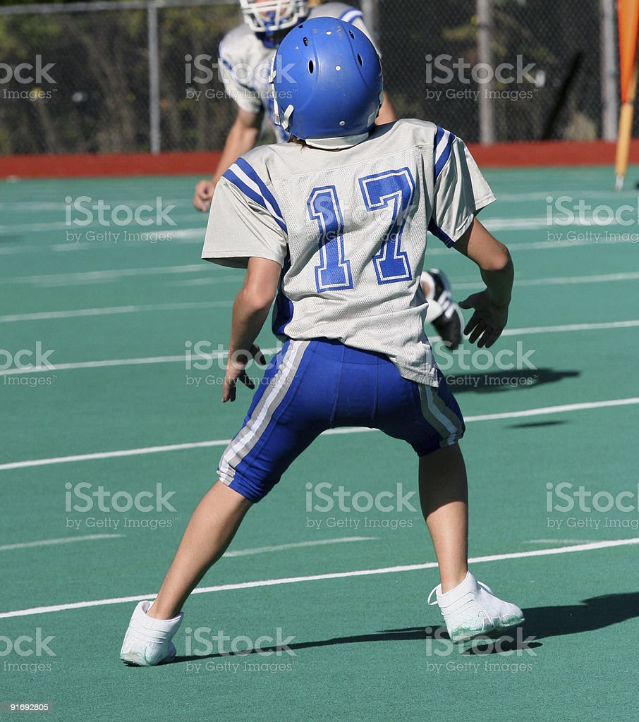Teen Youth Football Player Read to Catch Ball royalty-free stock photo