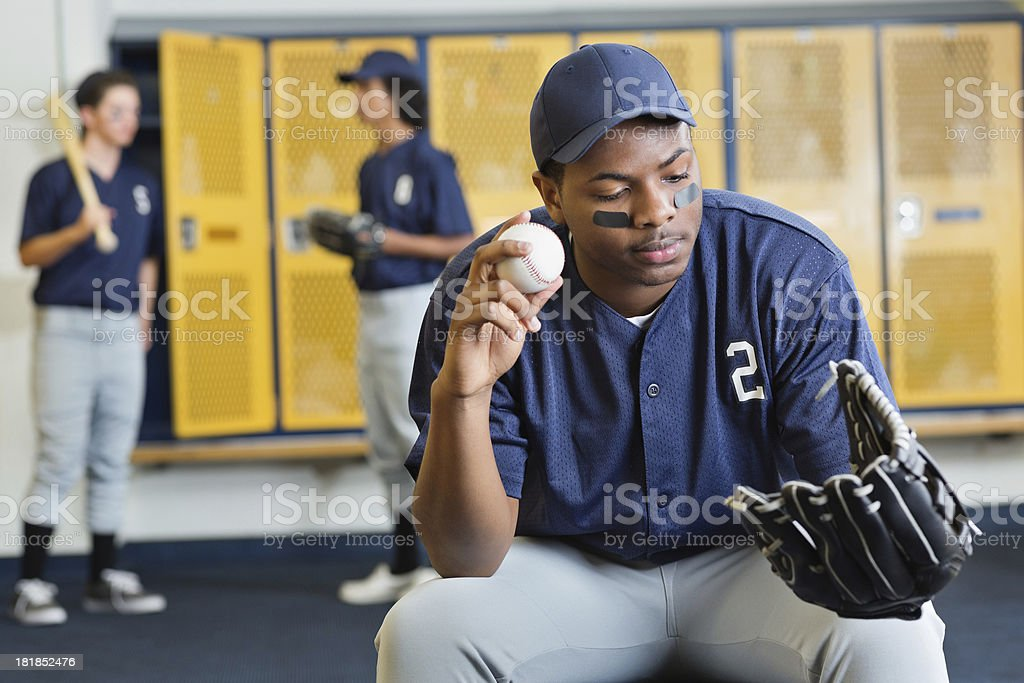 Teenage baseball pitcher in locker room after game royalty-free stock photo