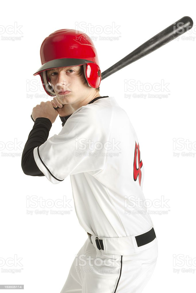 Teenage baseball player in uniform stock photo