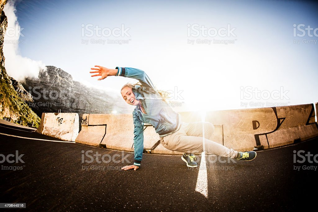 Teenage b-girl breakdancing with strength and flexibility stock photo