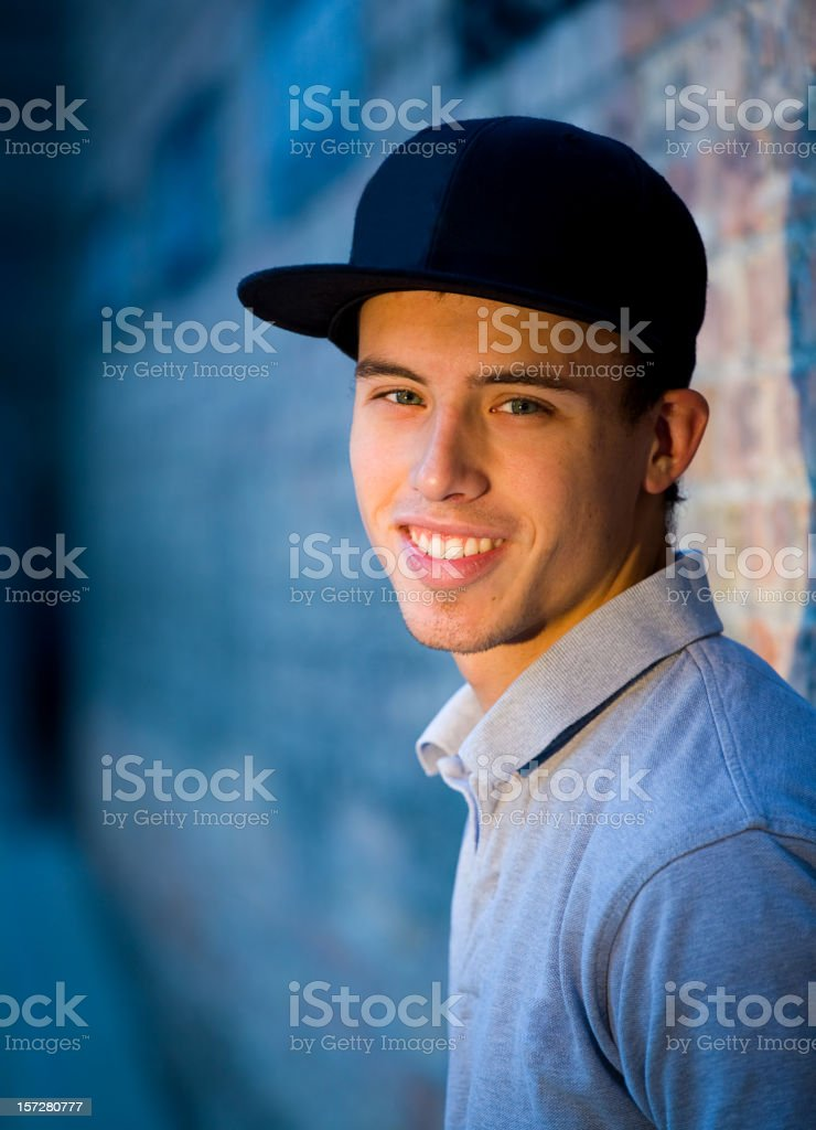 Teenage Boy against Brick Wall royalty-free stock photo