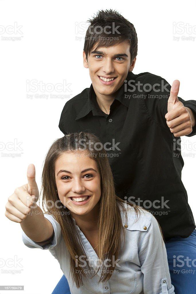 Jeune Garçon et fille de sourire et donne Pouce levé photo libre de droits