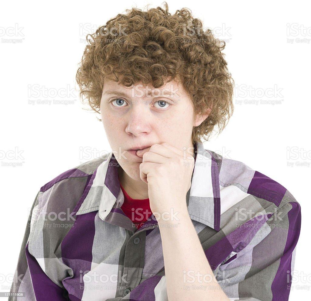 Teenage Boy Biting Fingernail royalty-free stock photo