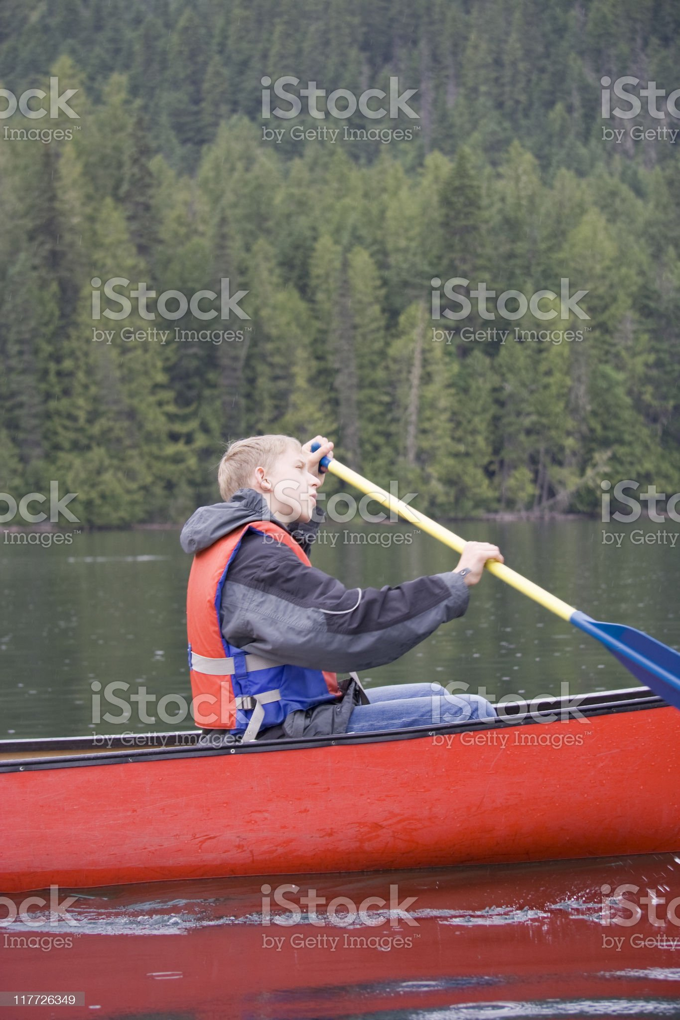 Teenage boy canoeing royalty-free stock photo