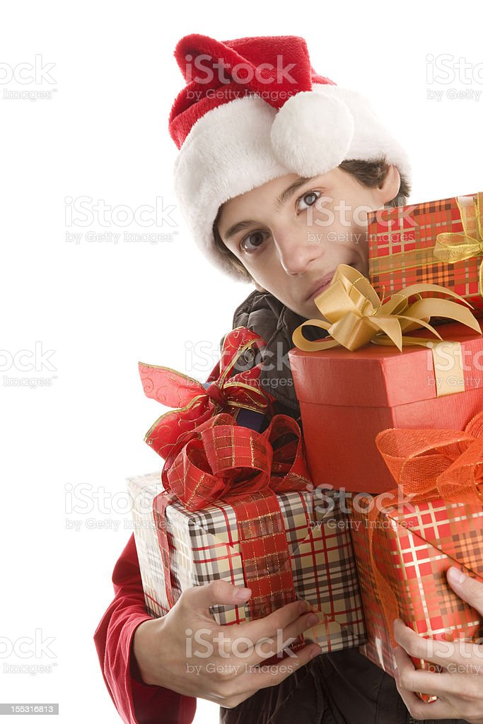 Teenage boy delivering Christmas gifts royalty-free stock photo