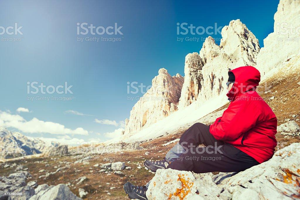 Teenage boy enjoying the view in Dolomites national park stock photo