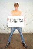 Teenage boy holding sign