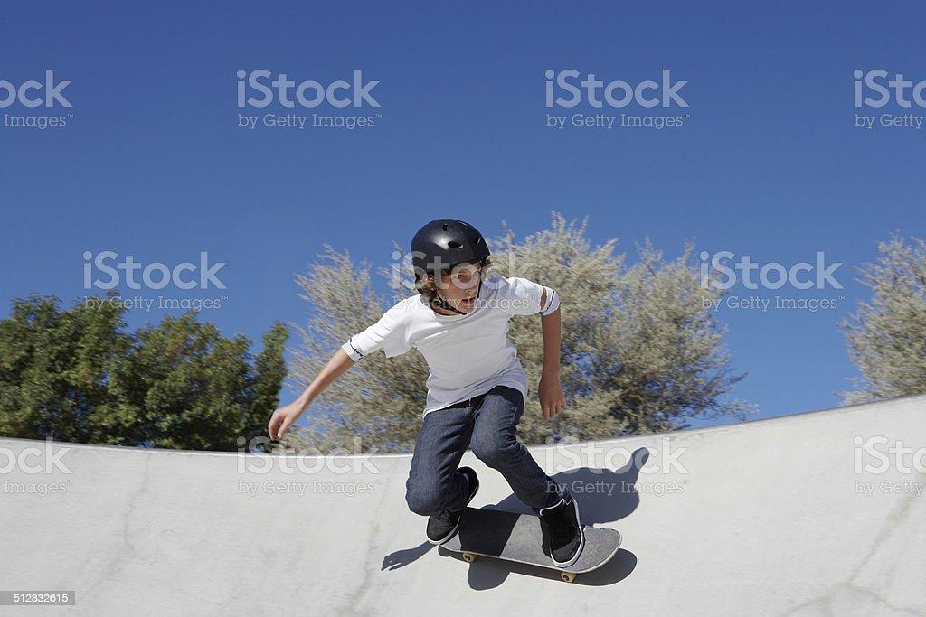 Teenage Boy In Skateboard Park stock photo