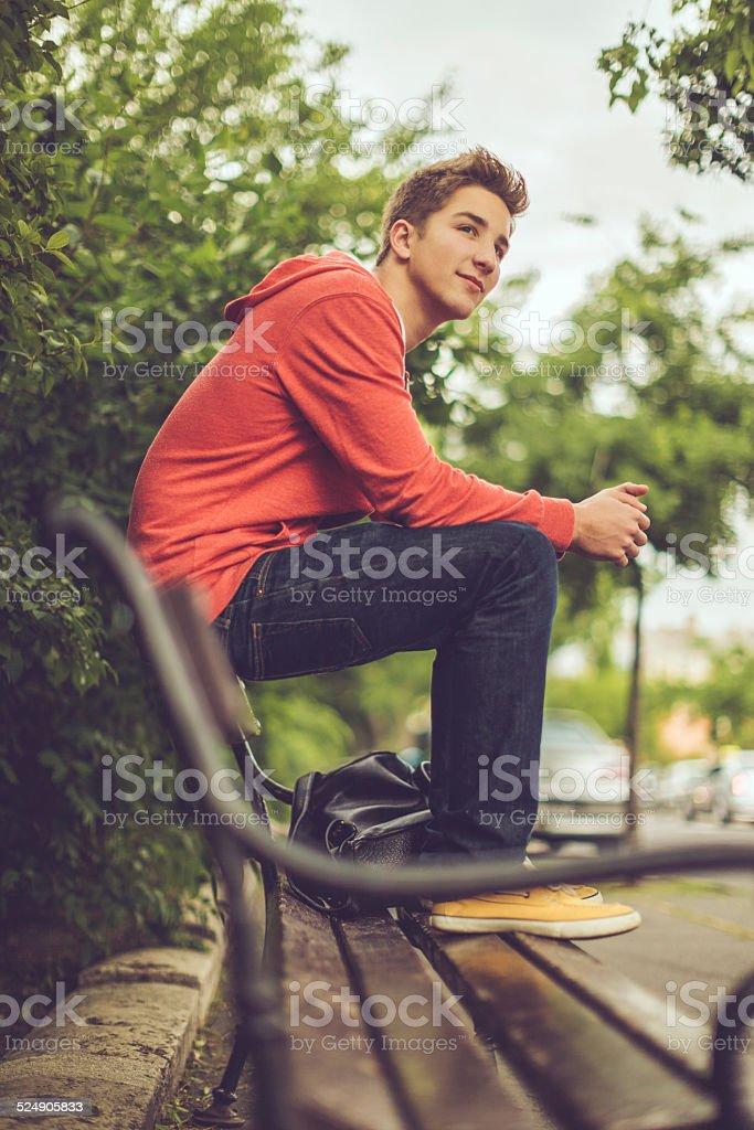 Teenage boy in the city stock photo