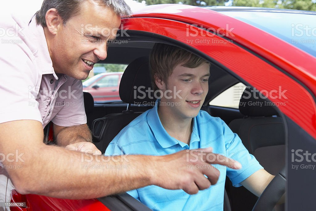 Teenage Boy Learning How To Drive stock photo